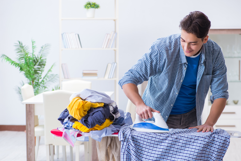 Sober Summer man ironing clothes before sober vacation
