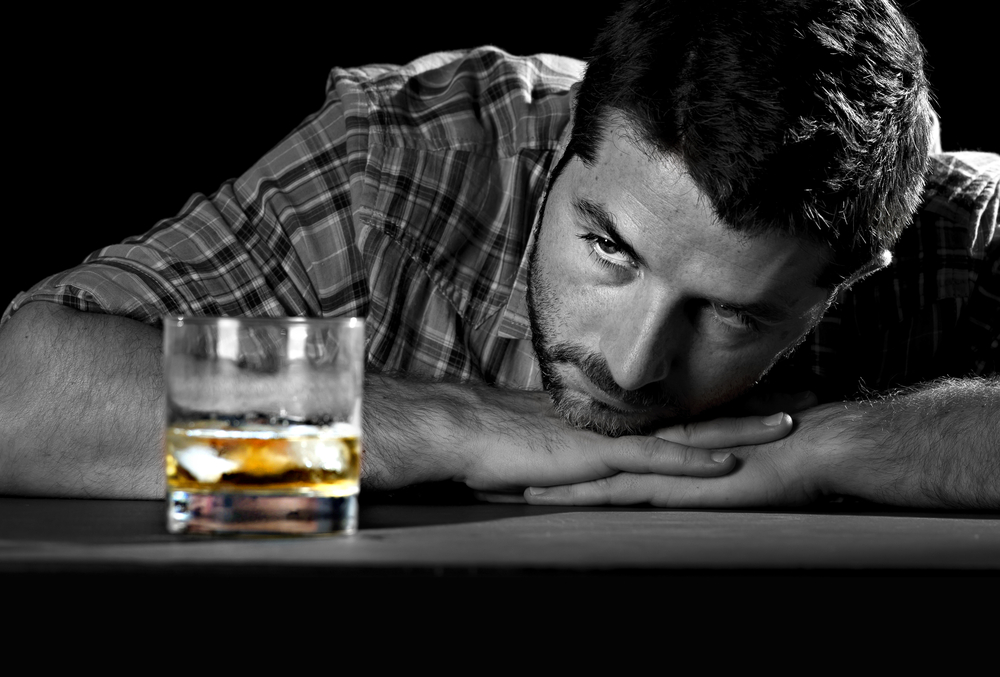 Domestic Violence and Addiction sad man with an alcohol problem