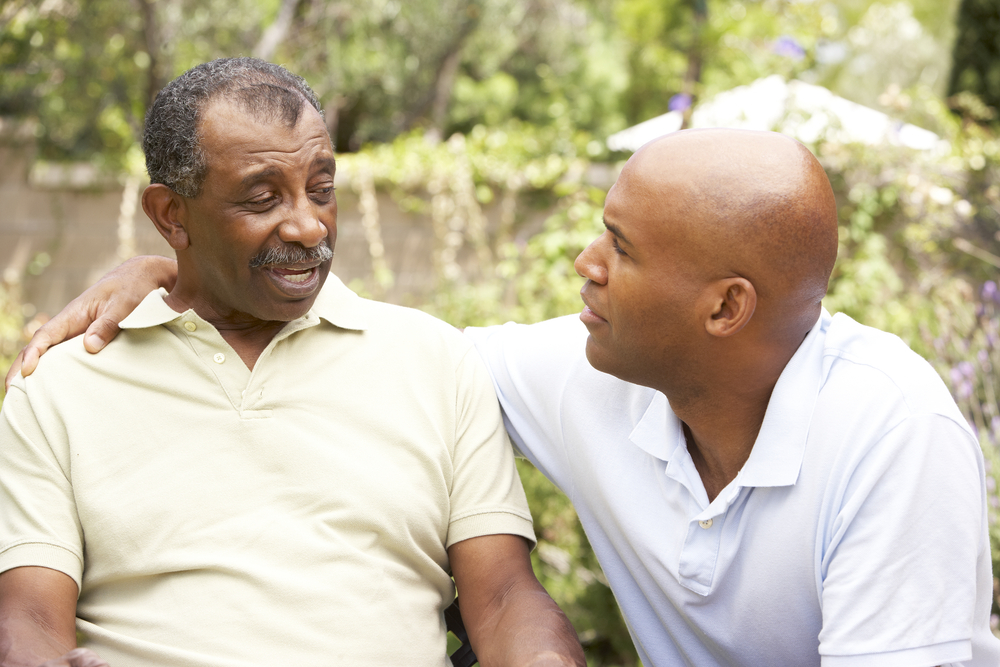 senior man talking to a family member