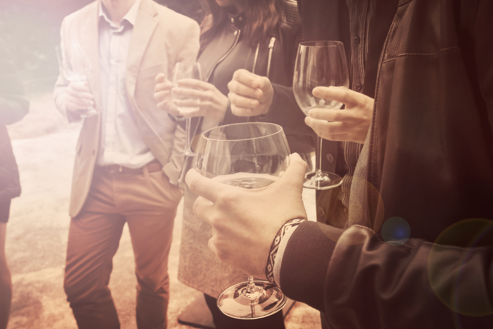 Link Between Mental Health and Addiction friends drinking wine together