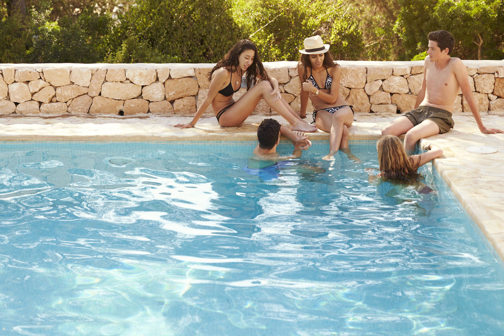 friends talking in a pool